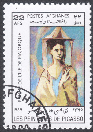 pablo picasso: MOSCOW, RUSSIA - CIRCA FEBRUARY, 2016: a post stamp printed in AFGHANISTAN shows painting Spanish woman from Majorca island by Picasso, the series Paintings by Pablo Picasso, circa 1989