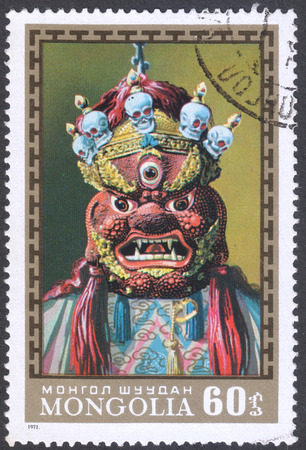 appalling: MOSCOW, RUSSIA - CIRCA FEBRUARY, 2016: a post stamp printed in MONGOLIA shows a traditional Mongol mask, the series Mongol Tsam Masks, circa 1971