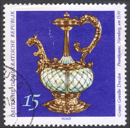 sumptuous: MOSCOW, RUSSIA - CIRCA FEBRUARY, 2016: a post stamp printed in DDR shows a sumptuous pot, the series Treasures fron the Green Vault Dresden, circa 1971