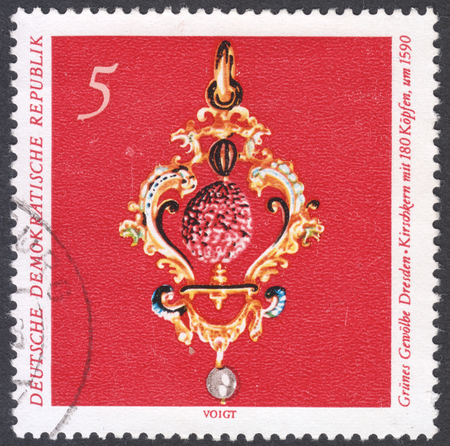 perforated: MOSCOW, RUSSIA - CIRCA FEBRUARY, 2016: a post stamp printed in DDR shows Cherry stone, the series Treasures fron the Green Vault Dresden, circa 1971