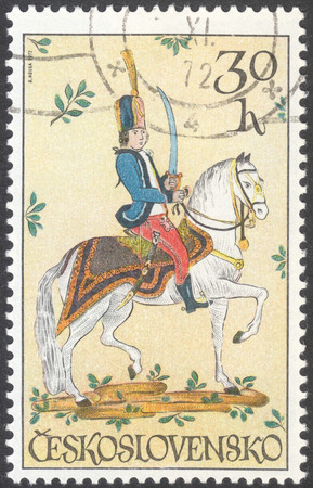 hussar: MOSCOW, RUSSIA - CIRCA FEBRUARY, 2016: a post stamp printed in CZECHOSLOVAKIA shows a hussar, the series Horsemanship. Ceramics and Glass, circa 1972