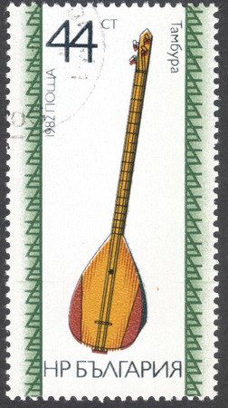 MOSCOW, RUSSIA - CIRCA FEBRUARY, 2016: a post stamp printed in BULGARIA shows  a traditional Bulgarian musical instrument, the series Folk Instruments, circa 1982 Editorial