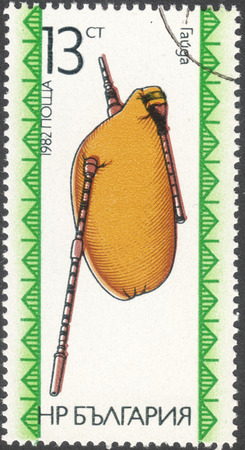 gitar: MOSCOW, RUSSIA - CIRCA FEBRUARY, 2016: a post stamp printed in BULGARIA shows  a traditional Bulgarian musical instrument, the series Folk Instruments, circa 1982 Editorial