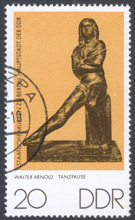 ddr: MOSCOW, RUSSIA - CIRCA MAY, 2016: a post stamp printed in DDR shows a sculpture Dance break by Walter Arnold, the series Small Plastics, circa 1976