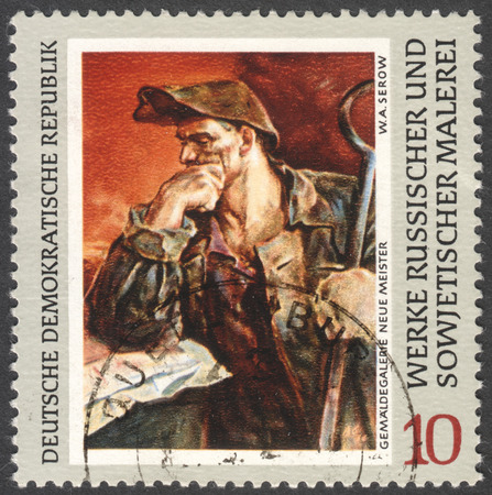 ddr: MOSCOW, RUSSIA - CIRCA FEBRUARY, 2016: a stamp printed in DDR shows a painting Steel-worker by Serov, the series Russian Paintings circa 1969