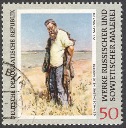 ddr: MOSCOW, RUSSIA - CIRCA FEBRUARY, 2016: a stamp printed in DDR shows a painting Man on the river by Makovsky, the series Russian Paintings circa 1969