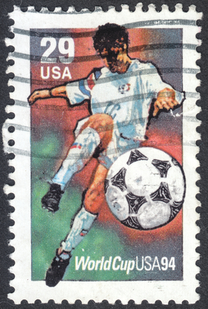 football world cup: MOSCOW, RUSSIA - CIRCA APRIL, 2016: a post stamp printed in the USA shows a football player, the series Football World Cup - USA, circa 1994