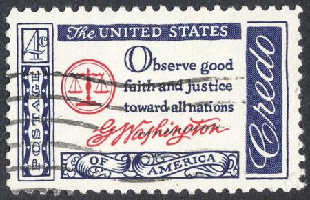 credo: MOSCOW, RUSSIA - CIRCA APRIL, 2016: a post stamp printed in the USA shows the  inscription Observe Good Faith and Justice Toward All Nations (Washington), the series American Credo, circa 1960 Editorial
