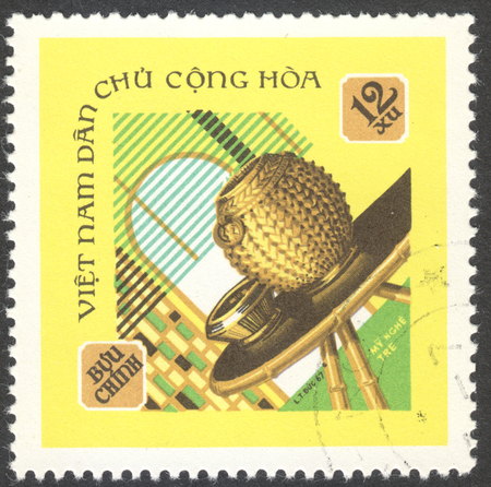 commodities: MOSCOW, RUSSIA - CIRCA APRIL, 2016: a post stamp printed in VIETNAM shows commodities from bamboo, the series Local crafts, circa 1968