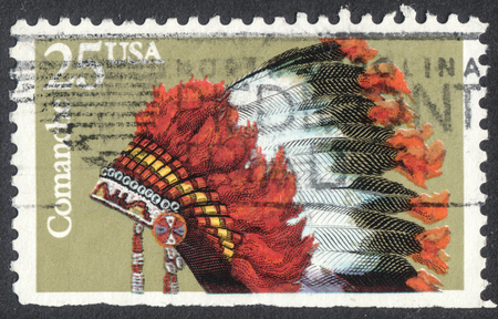 indigene: MOSCOW, RUSSIA - CIRCA APRIL, 2016: a post stamp printed in the USA shows an indian headdresses of the tribe Comanche, the series  Indian Headdresses, circa 1990