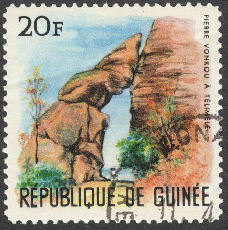 floating bridge: MOSCOW, RUSSIA - CIRCA APRIL, 2016: a post stamp printed in GUINEA shows a local scenery, the series Landscapes, circa 1966