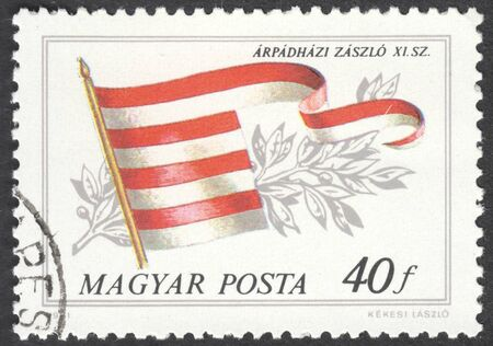house series: MOSCOW, RUSSIA - CIRCA APRIL, 2016: a post stamp printed in HUNGARY shows a flag of the House of Arpad, the series Historical Flags, circa 1981
