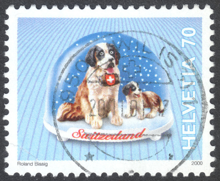 st bernard: MOSCOW, RUSSIA - CIRCA MAY, 2016: a post stamp printed in SWITZERLAND shows a St. Bernard dog, the series Snow Globes, circa 2000