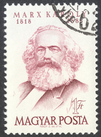 marx: MOSCOW, RUSSIA - CIRCA APRIL, 2016: a post stamp printed in HUNGARY shows a portrait of Karl Marx, dedicated to the 70th Anniversary of the Death of Karl Marx, circa 1953 Editorial