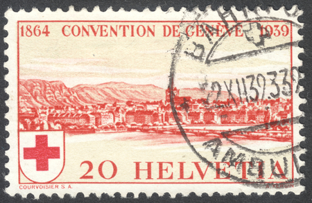 founding: MOSCOW, RUSSIA - CIRCA MAY, 2016: a post stamp printed in SWITZERLAND shows a view of Geneva, dedicated to the 75th Anniversary of the Founding of the International Red Cross Society, circa 1939