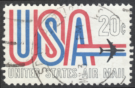 sello: MOSCOW, RUSSIA - CIRCA APRIL, 2016: a post stamp printed in the USA shows symbols of American Airmail, circa 1968