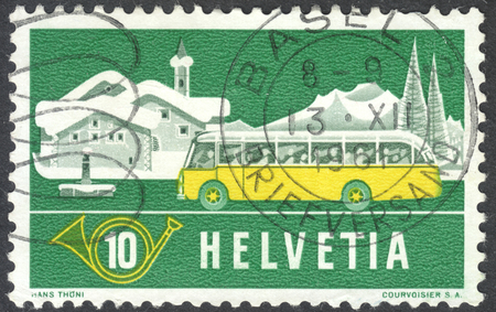 posthorn: MOSCOW, RUSSIA - CIRCA MAY, 2016: a post stamp printed in SWITZERLAND shows an Alpine post bus and winter background, the series Post in the Alps, circa 1953