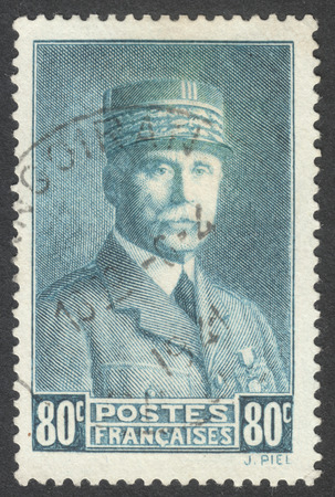 marshal: MOSCOW, RUSSIA - CIRCA APRIL, 2016: a post stamp printed in FRANCE shows a portrait of Marshal Petain, the series Marshal Petain, circa 1941