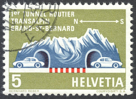 mount price: MOSCOW, RUSSIA - CIRCA APRIL, 2016: a post stamp printed in SWITZERLAND shows mountain massif with a tunnel, dedicated to the St. Bernhard Tunnel, circa 1964