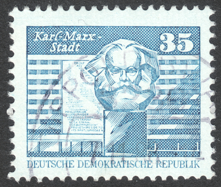 ddr: MOSCOW, RUSSIA - CIRCA APRIL, 2016: a post stamp printed in DDR shows Karl-Marx-Monument in front of new buildings, Chemnitz, the series Construction in the DDR, circa 1973
