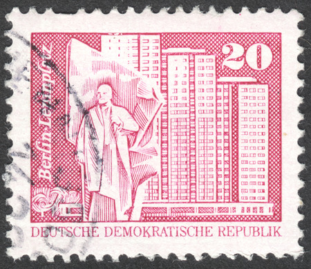 ddr: MOSCOW, RUSSIA - CIRCA APRIL, 2016: a post stamp printed in DDR shows Lenin monument, residential tower, Berlin, the series Construction in the DDR, circa 1973 Editorial