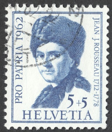 theorist: MOSCOW, RUSSIA - CIRCA MAY, 2016: a post stamp printed in SWITZERLAND  shows a portrait of Jean Jacques Rousseau, the series Pro Patria, circa 1962