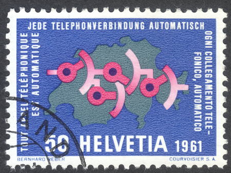 ideograph: MOSCOW, RUSSIA - CIRCA APRIL, 2016: a post stamp printed in SWITZERLAND  dedicated to fully automatic Swiss telephone service: Wiring diagram on map of Switzerland, circa 1961 Editorial