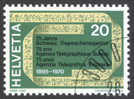 telegrama: MOSCOW, RUSSIA - CIRCA APRIL, 2016: a post stamp printed in SWITZERLAND shows a telex tape, dedicated to the 75th anniversary of the Swiss Telegraph Agency, circa 1970