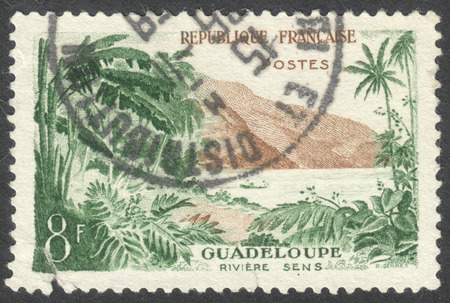 sens: MOSCOW, RUSSIA - CIRCA APRIL, 2016: a post stamp printed in FRANCE shows view of Sens River, Guadeloupe, the series Landscapes, circa 1957 Editorial