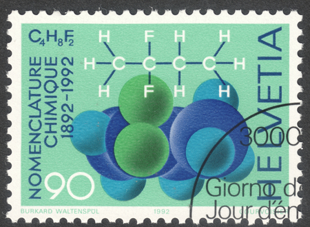 nomenclature: MOSCOW, RUSSIA - CIRCA MAY, 2016: a post stamp printed in SWITZERLAND shows Difluorbutane molecule: 3 different formula, dedicated to International Chemics Nomenclature Conference, circa 1992