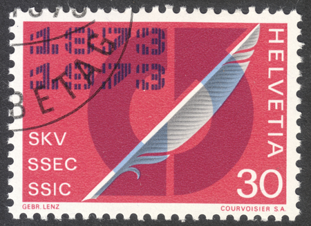 centenary: MOSCOW, RUSSIA - CIRCA MAY, 2016: a post stamp printed in SWITZERLAND shows a Quill Pen and arrows in circle, dedicated to Swiss Association of Commercial Employees centenary, circa 1973 Editorial