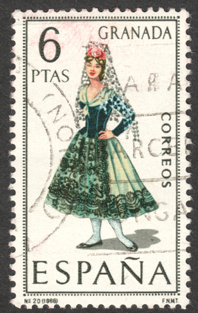 MOSCOW, RUSSIA - CIRCA APRIL, 2016: a post stamp printed in SPAIN shows a girl in costume of Granada, the series Regional Costumes, circa 1968