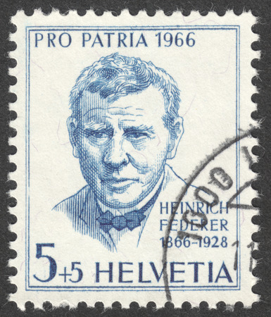 heinrich: MOSCOW, RUSSIA - CIRCA MAY, 2016: a post stamp printed in SWITZERLAND  shows a portrait of Heinrich Federer, the series Pro Patria, circa 1966 Editorial