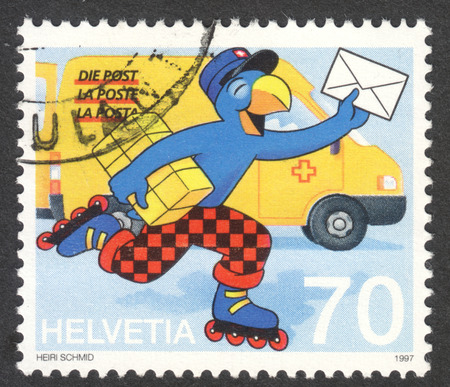helvetia: MOSCOW, RUSSIA - CIRCA MAY, 2016: a post stamp printed in SWITZERLAND shows a comic figure Globi as postman, dedicated to the 20th International Comics Festival, circa 1997