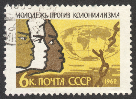 MOSCOW, RUSSIA - CIRCA APRIL, 2016: a post stamp printed in the USSR, dedicated to  International Solidarity of Youth against Colonialism Day, circa 1962