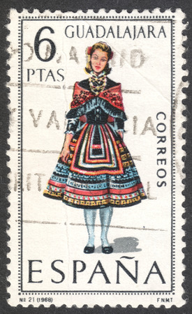 MOSCOW, RUSSIA - CIRCA APRIL, 2016: a post stamp printed in SPAIN shows a girl in costume of Guadalajara, the series Regional Costumes, circa 1968