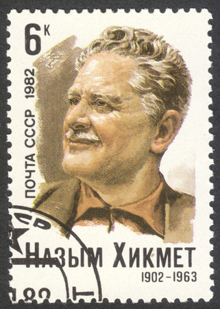 screenwriter: MOSCOW, RUSSIA - CIRCA MAY, 2016: a post stamp printed in the USSR dedicated to the 80th Birth Anniversary of Nazym Hikmet, circa 1982 Editorial