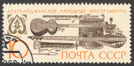 saz: MOSCOW, RUSSIA - CIRCA APRIL, 2016: a post stamp printed in the USSR shows Azerbaijan folk musical instruments, the series National Musical Instruments, circa 1990 Editorial