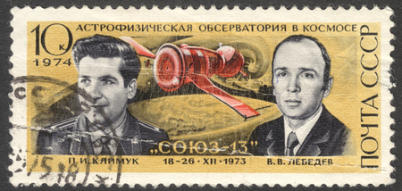 cosmonautics day: MOSCOW, RUSSIA - CIRCA APRIL, 2016: a post stamp printed in the USSR shows portrait of P. I. Klimuk and V. V. Lebedev, the series Cosmonautics Day, circa 1974 Editorial