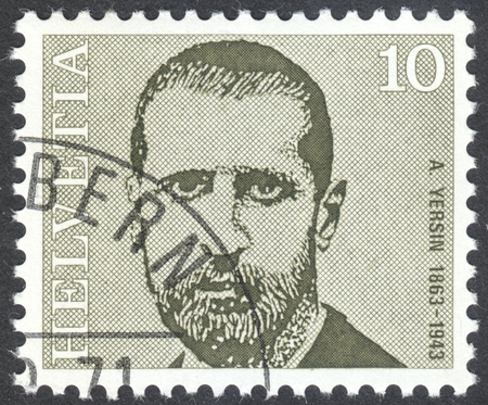 boffin: MOSCOW, RUSSIA - CIRCA APRIL, 2016: a post stamp printed in SWITZERLAND  shows a portrait of Alexandre Yersin, the series Doctors, circa 1971