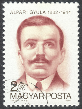 anti fascist: MOSCOW, RUSSIA - CIRCA APRIL, 2016: a post stamp printed in HUNGARY shows a portrait of Gyula Alpari, devoted to the 100th Anniversary of the Birth of Gyula Alpari, circa 1982 Editorial