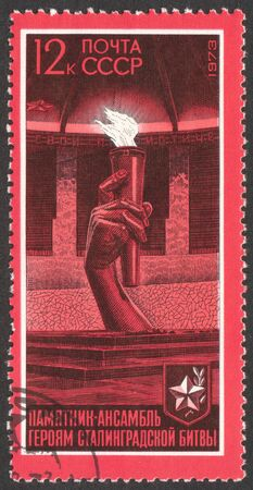 grieve: MOSCOW, RUSSIA - CIRCA MAY, 2016: a post stamp printed in the USSR shows the Eternal fire, the series The 30th Anniversary of Stalingrad Victory, circa 1973
