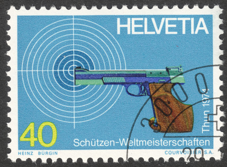 MOSCOW, RUSSIA - CIRCA APRIL, 2016: a post stamp printed in SWITZERLAND, devoted to World Marksmanship Championship, Thun, circa 1974 Editorial