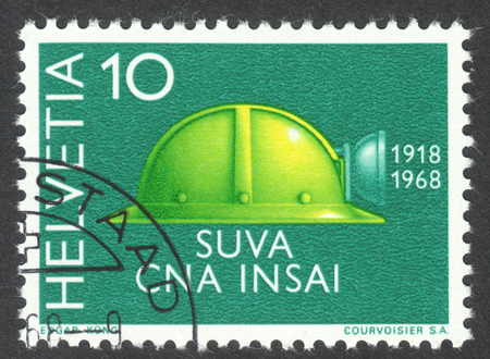 MOSCOW, RUSSIA - CIRCA APRIL, 2016: a post stamp printed in SWITZERLAND shows a helmet, circa 1968 Editorial