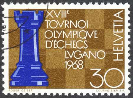olympics: MOSCOW, RUSSIA - CIRCA APRIL, 2016: a post stamp printed in SWITZERLAND shows a chess board, devoted to the 18th Chess Olympics, Lugano, circa 1968 Editorial