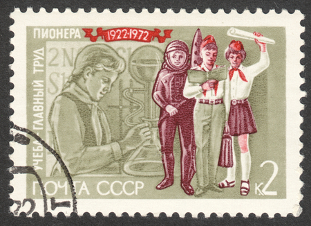 pioneer: MOSCOW, RUSSIA - CIRCA APRIL, 2016: a post stamp printed in the USSR shows pioneers, the series The 50th Anniversary of Pioneer Organization Editorial