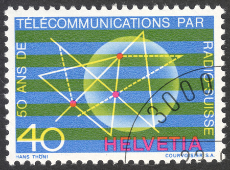 helvetia: MOSCOW, RUSSIA - CIRCA APRIL, 2016: a post stamp printed in SWITZERLAND, the series Swiss Alps - The 50th Anniversary of the Radio Switzerland, circa 1971 Editorial