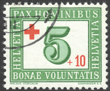 helvetica: MOSCOW, RUSSIA - CIRCA JULY, 2016: a post stamp printed in SWITZERLAND with inscription Pax hominibus, bonae voluntatis, dedicated to Red Cross, circa 1945