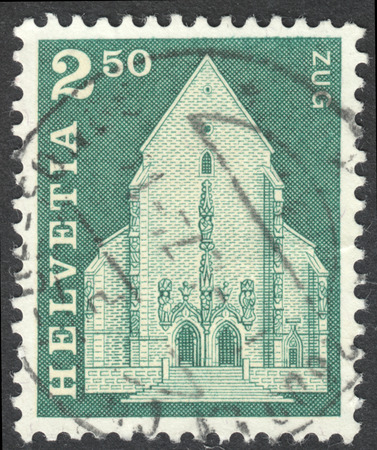 MOSCOW, RUSSIA - CIRCA JUNE, 2016: a post stamp printed in SWITZERLAND shows St. Oswalds Church, Zug, circa 1967 Editorial