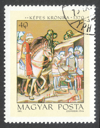 beheading: MOSCOW, RUSSIA - CIRCA JUNE, 2016: a post stamp printed in HUNGARY shows The Beheading of Heathen Chief Koppany, the series Miniatures from Chronicle of King Lajos I, circa 1971
